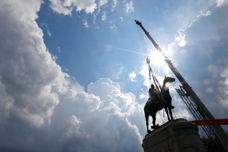 Work crews work to remove the statue of confederate general Stonewall Jackson, Wednesday, July 1, 2020, in Richmond, Va.