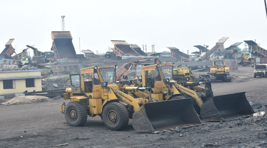 Mining equipment stands idle at Ena Colliery of BCCL in Dhanbad on Thursday