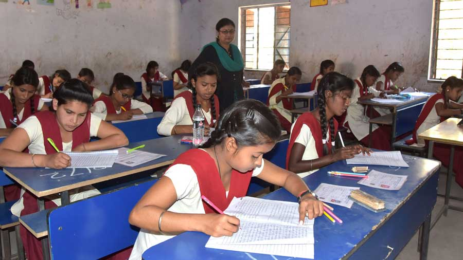 Students during the Jharkhand Academic Council Secondary Examination at BSS Bal Bari Middle School in Dhanbad
