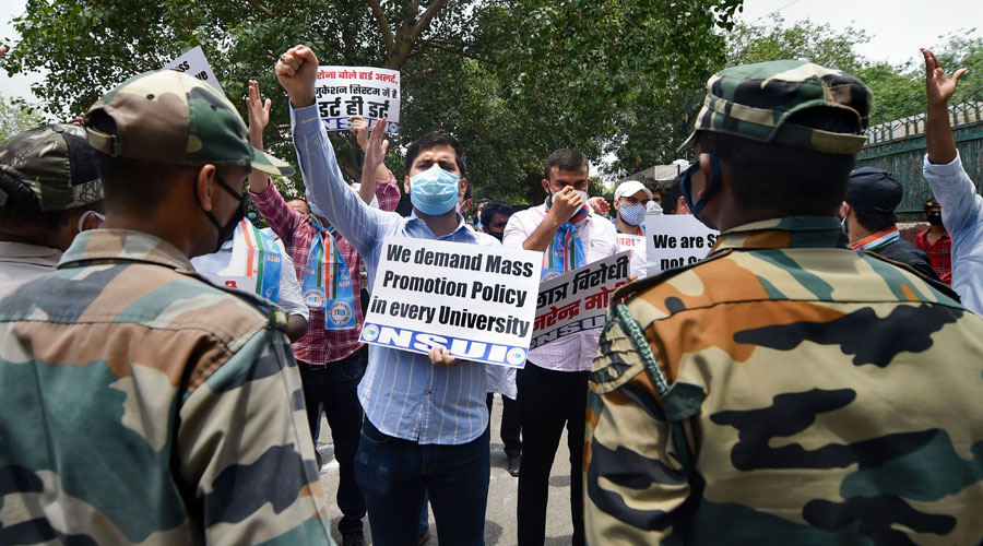 NSUI members demanding cancellation of exams, waiving off semester fee, and promotion of all students, New Delhi, Wednesday, July 1, 2020