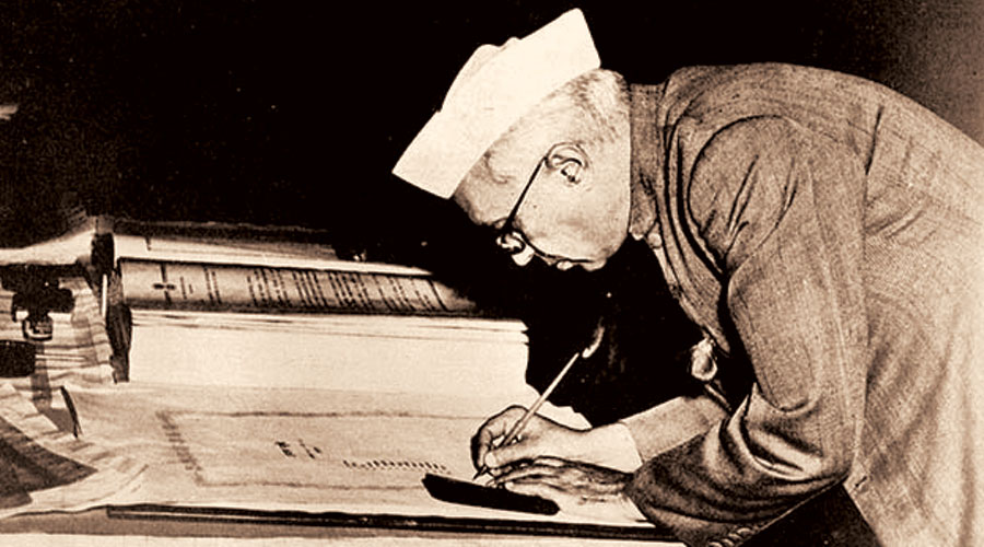 Jawaharlal Nehru signing the Constitution of India. New Delhi, 24 January 1950.