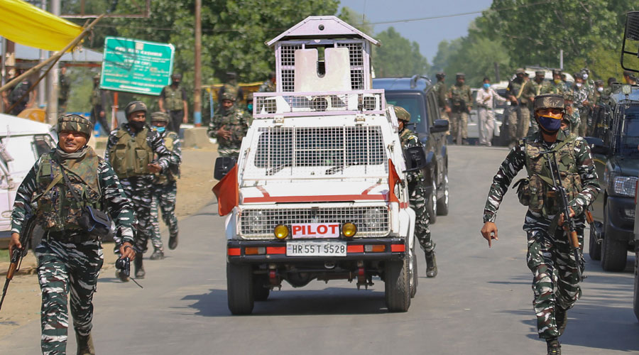 Security personnel conduct a search operation after militants opened fire on a naka party of CRPF, at Sopore, Jammu & Kashmir