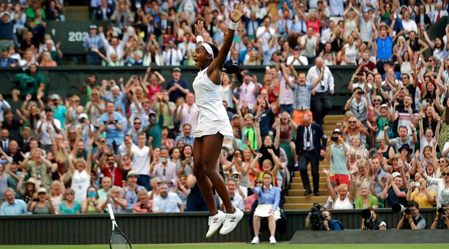 US' Cori Gauff celebrates after beating Slovenia's Polona Hercog in a women's singles in Wimbledon as spectators cheer