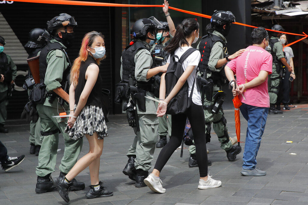 Police detain protesters after a protest in Causeway Bay before the annual handover march in Hong Kong, Wednesday, July. 1, 2020.