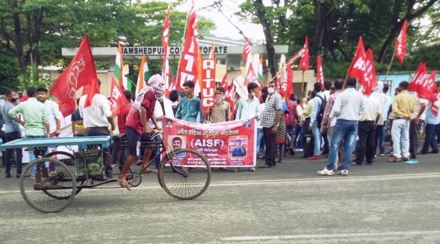Trade union activists protest at Jamshedpur collectorate on Friday in total disregard for social distancing norms.