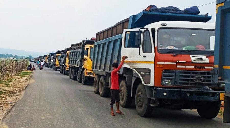 Stranded coal trucks on the Hazaribagh-Barkagaon road ion Friday.