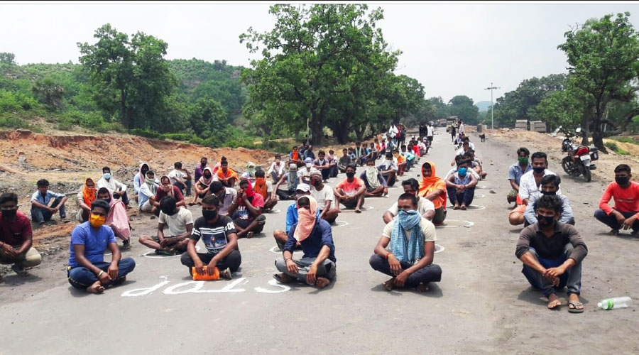 Villagers sit on the Hazaribagh-Barkagaon road blocking coal transportation on Friday.