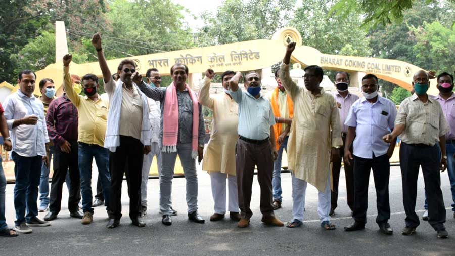 A joint front of trade union leaders stage a demonstration in front of the BCCL headquarters at Koyla Bhawan in Dhanbad on Friday, during the second day of their three-day strike today in protest against the commercialisation of mining