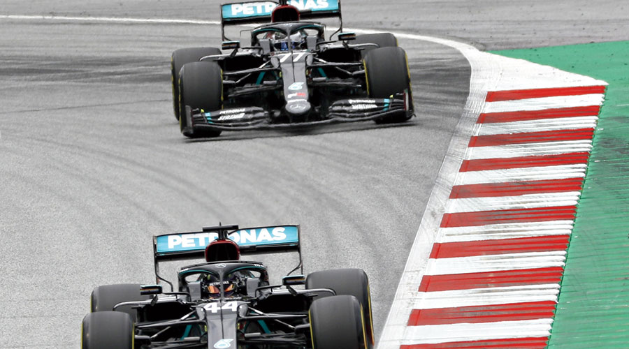 Mercedes driver Lewis Hamilton is followed by  teammate Valtteri Bottas during the second practice session