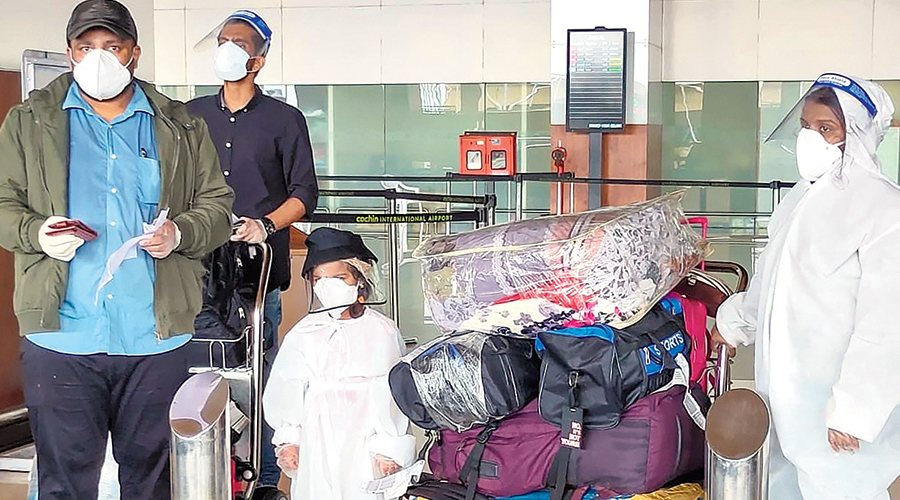 Passengers arrive on relief flights at Cochin Airport in June.