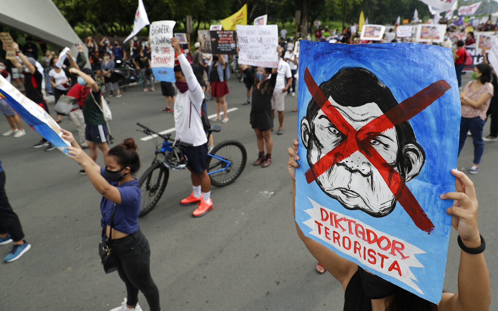 Protesters raise slogans during a rally against the anti-terror law at the University of the Philippines in Manila, Philippines on Saturday, July 4, 2020. Philippine President Rodrigo Duterte on Friday signed a widely opposed anti-terror law which critics fear could be used against human rights defenders and to muzzle dissent.