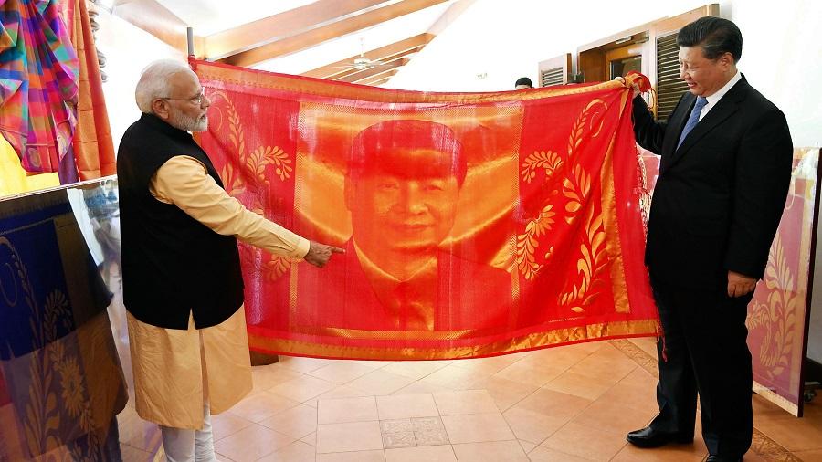 Prime Minister Narendra Modi presents a hand-woven portrait to Chinese President Xi Jinping at Mahabalipuram