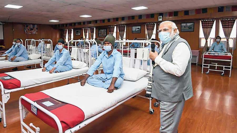 Prime Minister Narendra Modi meets soldiers who were injured in the Galwan Valley clash at Leh in Ladakh on Friday.