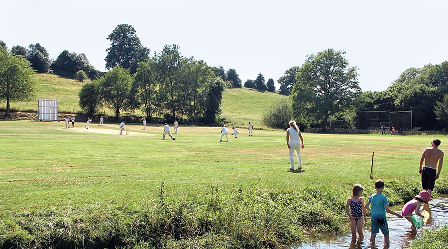 A cricket match under way in England