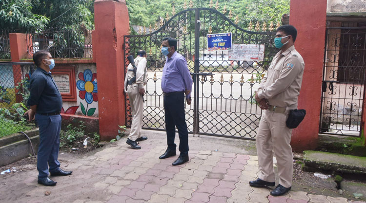 SDM Raj Maheshwaram (in purple shirt), along with an official and security force personnel, supervise the sealing of Dhanbad Press Club on Sunday