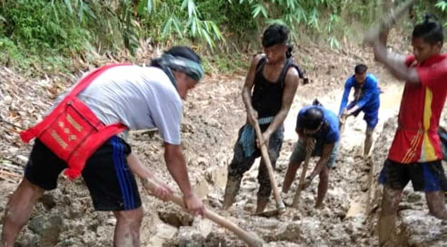 Villagers work on the Rymbai-Bataw-Borkhat-Sonapur road