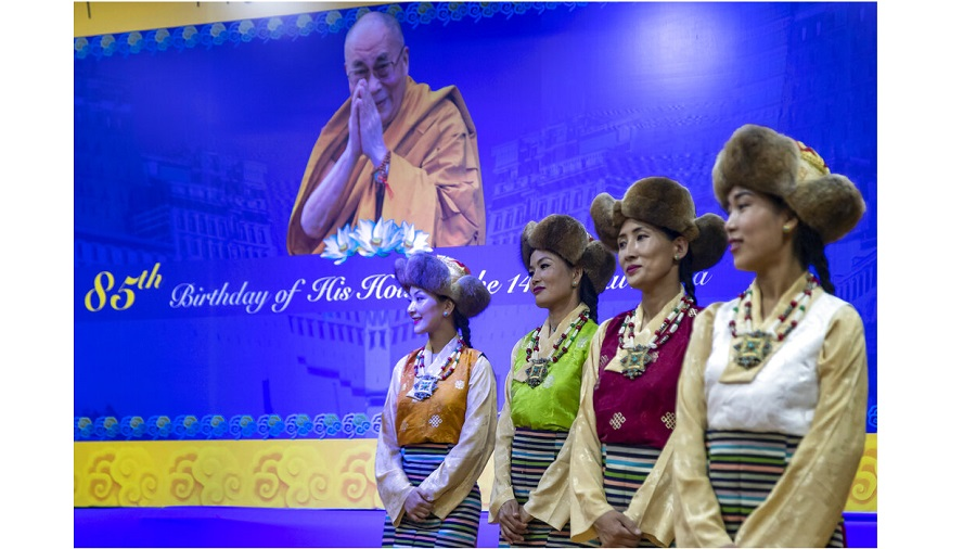 Exile Tibetan artists perform a special song to mark the 85th birthday of their spiritual leader the Dalai Lama in Dharmsala on Monday