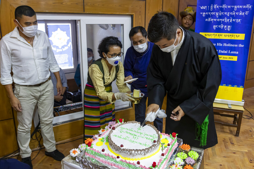 Lobsang Sangay, the president of the Central Tibetan Administration cuts a cake to mark his spiritual leader the Dalai Lama's 85th birthday in Dharmsala, India, Monday, July 6, 2020.