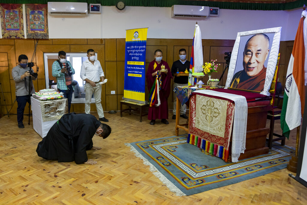 Lobsang Sangay, the president of the Central Tibetan Administration bows in front of a portrait of his spiritual leader the Dalai Lama during an official function to mark the the Tibetan leader's 85th birthday in Dharmsala, India, Monday, July 6, 2020.