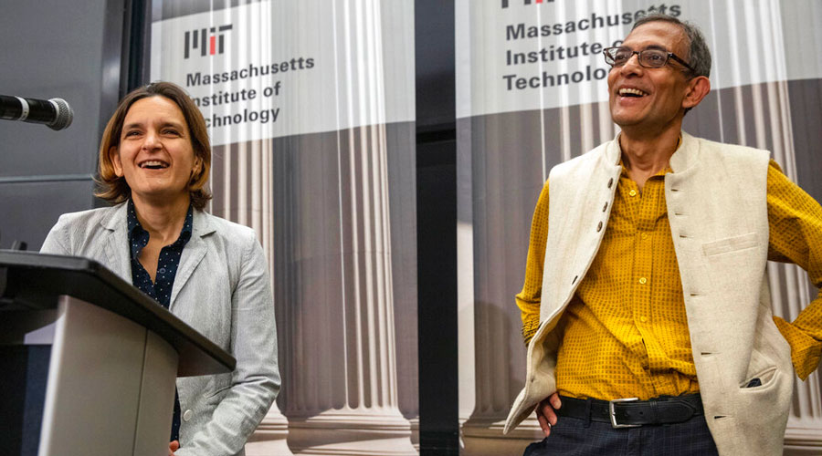 Esther Duflo and Abhijit Banerjee speak during a news conference at MIT on October 14.