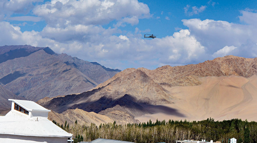 An IAF helicopter flies in Leh, Ladakh, on Monday.