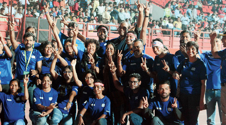 Fans cheer for their team during an ISL match between Jamshedpur FC and FC Goa in 2018