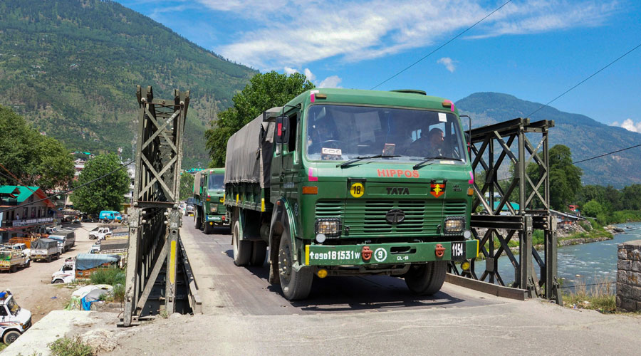 Indian army trucks depart towards Ladakh amid stand off between Indian and Chinese troops in eastern Ladakh, at Manali-Leh highway in Kullu district on Monday.