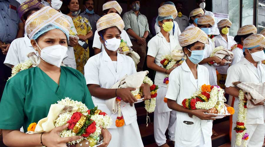 Nurses being honoured for their services in taking care of Covid-19 patients, at KIMS hospital in Dharwad, Karnataka, Friday, July 3, 2020.