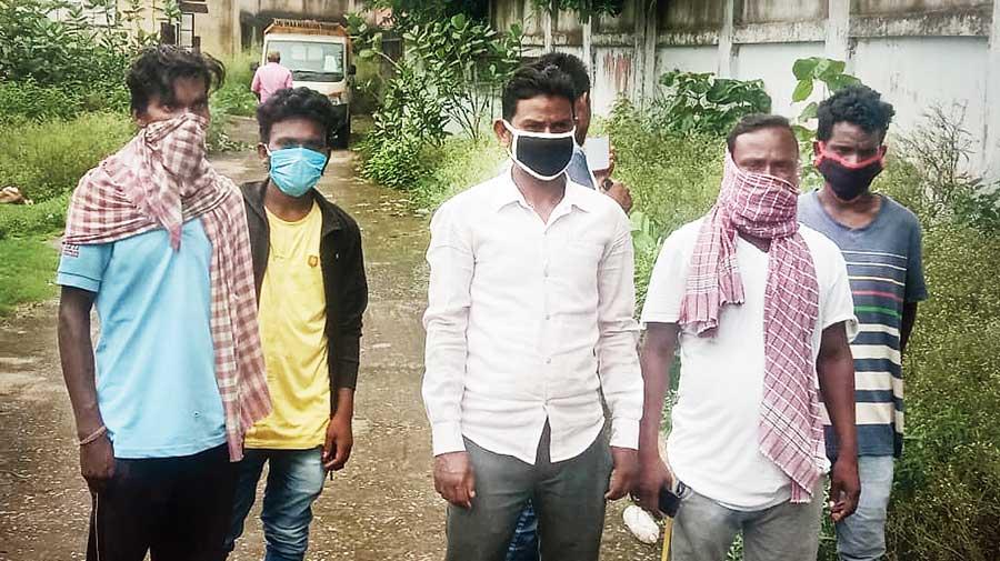 Relatives of the deceased woman wait outside the Seraikela Sadar Hospital  on Tuesday.