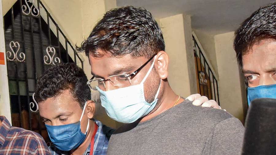 Customs officials produce Sarith, a former UAE consulate employee arrested for smuggling gold, before a court in Kochi on Tuesday.