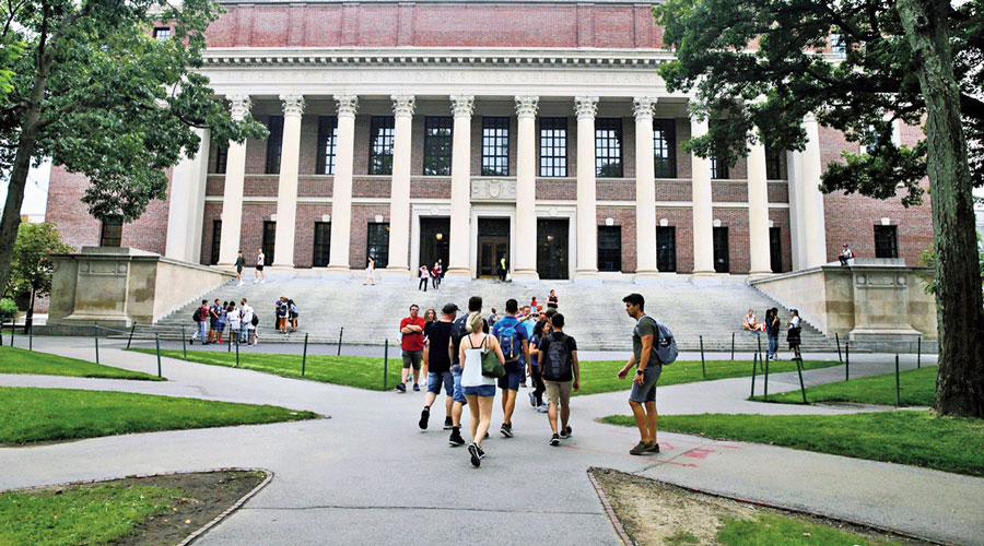 A file picture shows students near the Widener Library at Harvard University in Cambridge, Massachusetts.