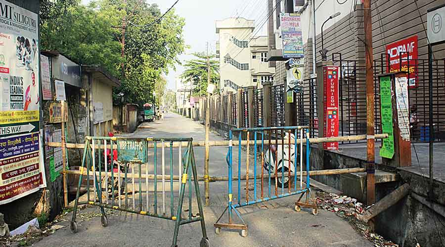 This March 4, 2020 photo shows a sealed entry point to Jyotinagar in Siliguri