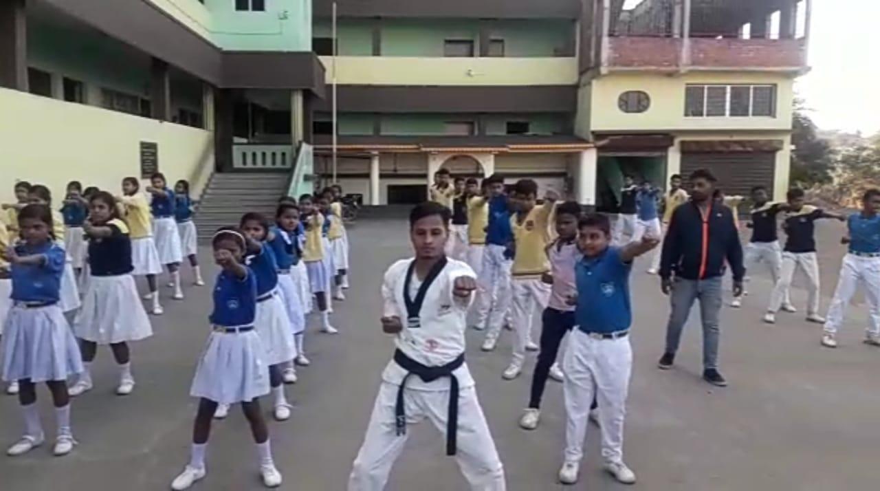 Amit Modak trains students at a school in Gamharia