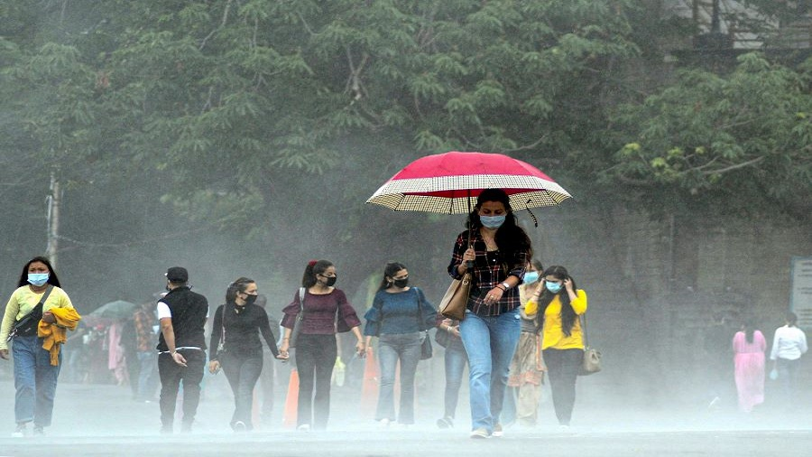 People walk along the ridge during rainfall, in Shimla, Tuesday, July 7, 2020.