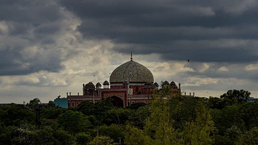 Monsoon clouds hover over Humayun's Tomb, during Unlock 2.0, in New Delhi, Tuesday, July 7, 2020.
