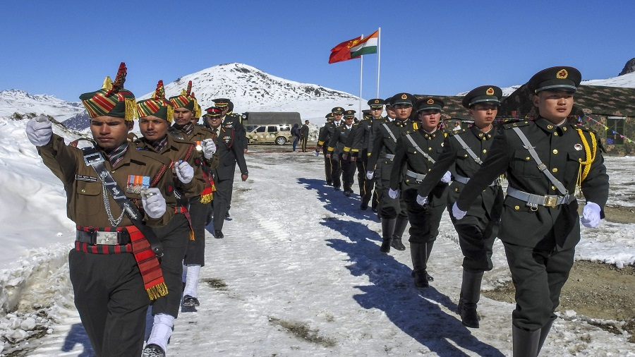 Indian and Chinese soldiers celebrate the 2019 New Year at Bumla along the India-China border in Arunachal Pradesh