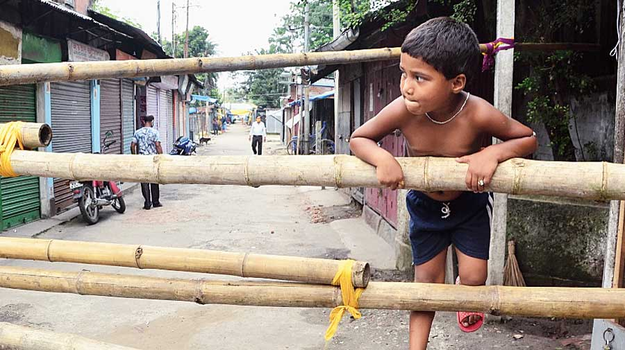 A child climbs a barricade at New Cinema Road in Siliguri on Wednesday.