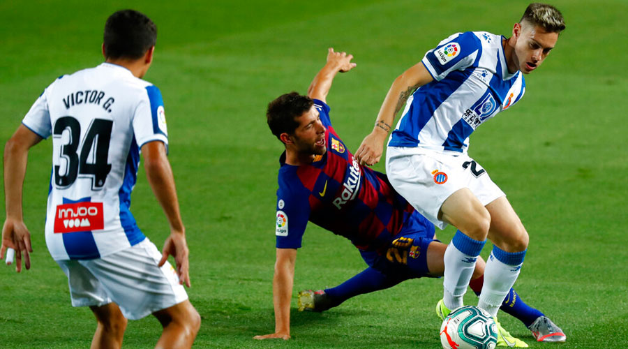 Sergi Roberto fights for the ball against Pol Lozano (right) during the Spanish La Liga soccer match between FC Barcelona and RCD Espanyol in Barcelona on Wednesday.