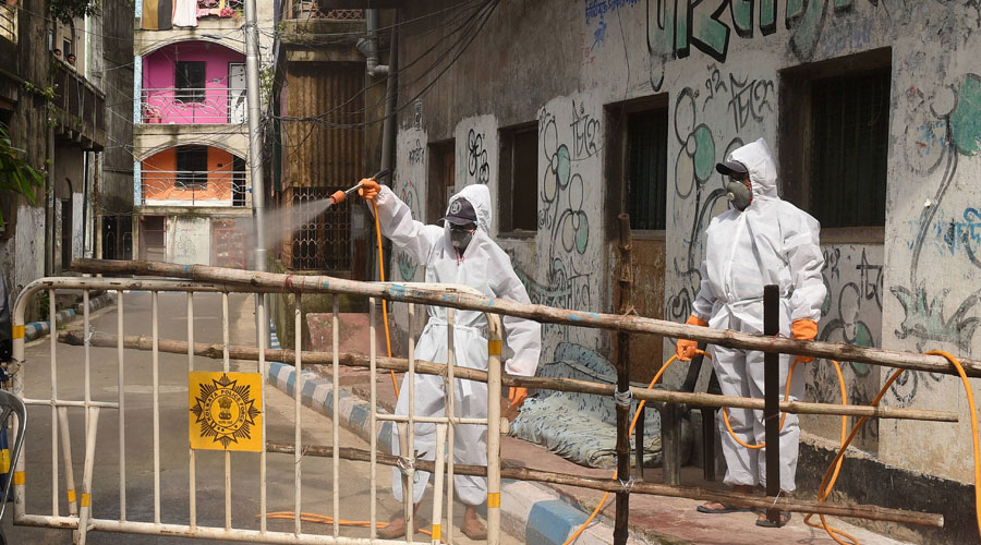 CMC workers sanitise a containment zone in Calcutta on Thursday, July 9
