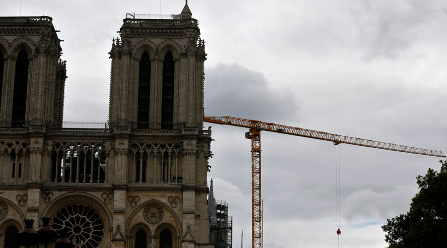 A crane stands by Notre Dame Cathedral on Friday, July 10, 2020 in Paris.