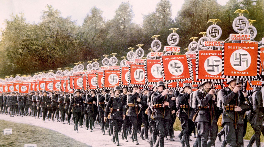 Nazi SS troops marching with victory standards at the Party Day rally in Nuremberg, 1933