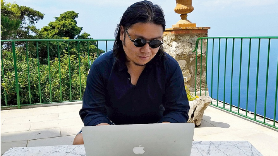 Kevin at work  in Capri writing his novel Sex and Vanity