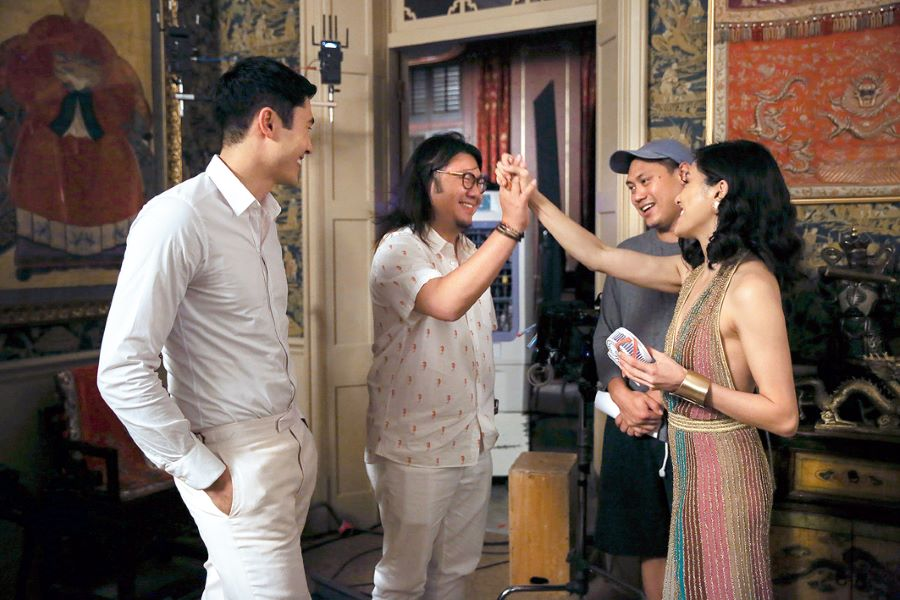 Kwan on the Tyersall Park set in Kuala Lumpur with Henry Golding, Jon M. Chu and Constance Wu.