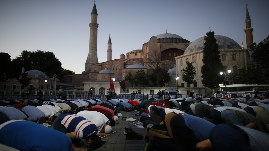 People offer the evening prayer outside the Hagia Sophia on July 10