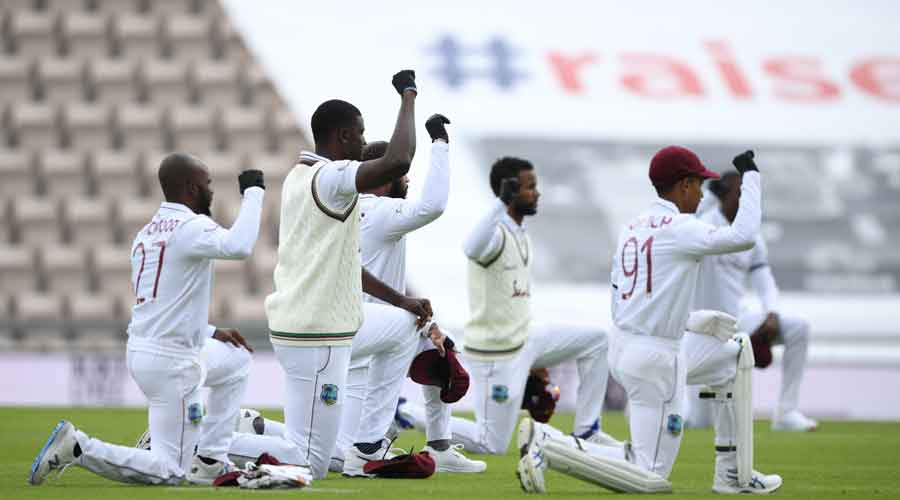 West Indies captain Jasion Holder (second from left) and his teammates take a knee before the start of the first day of the Test between the team and England in Southampton on July 8