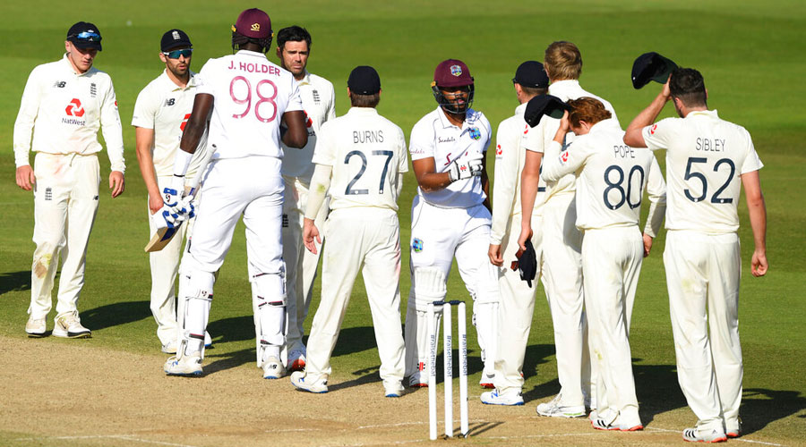 West Indies batsmen greet England players after winning the first Test match at the Ageas Bowl in Southampton on Sunday.