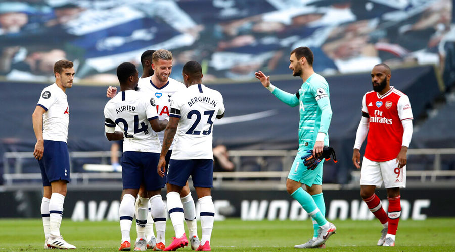 Tottenham players celebrate after the end of their EPL match against Arsenal in London on Sunday.