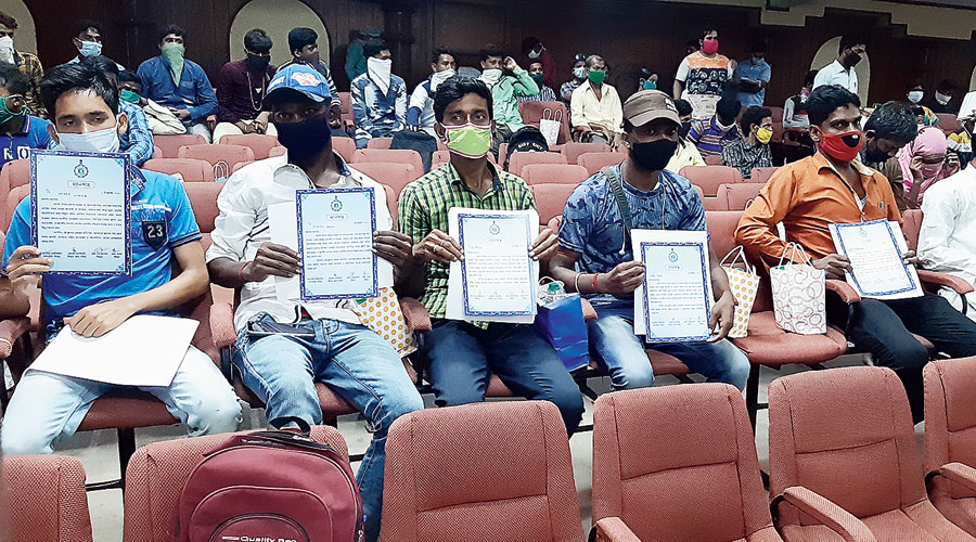 Newly designated Covid warriors from Birbhum attend a meeting.