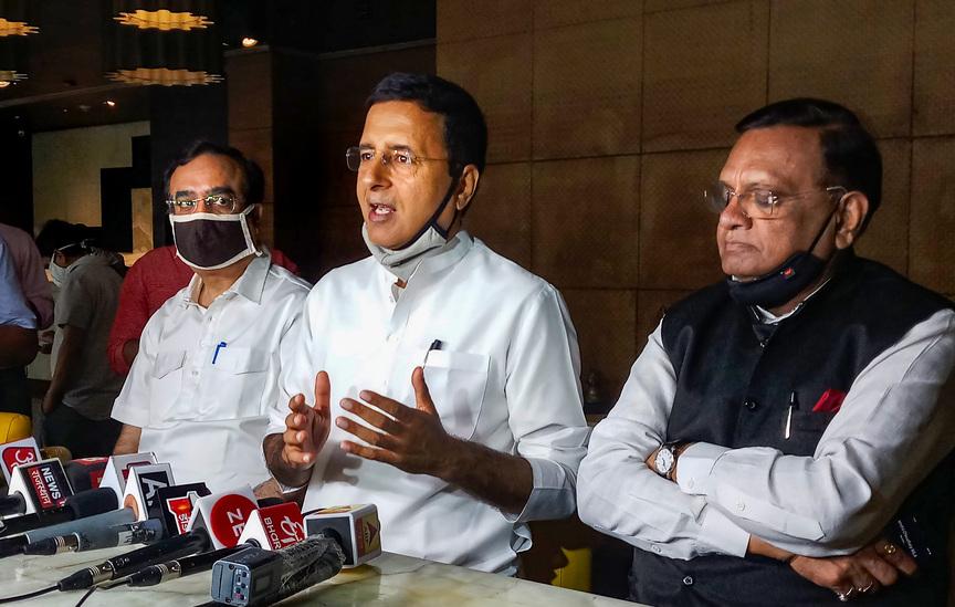 Congress leaders Randeep Surjewala, Ajay Maken (L) and Avinash Pandey (R) address the media in Jaipur, Monday, July 13, 2020