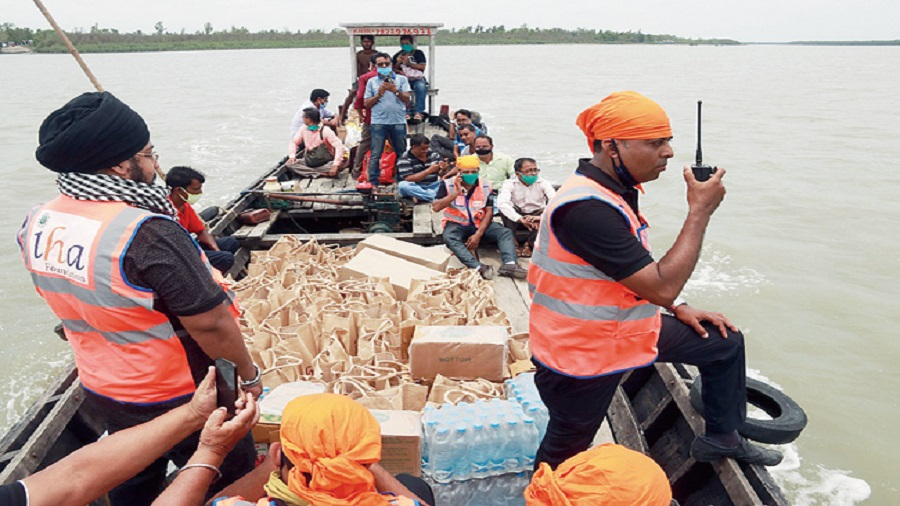 IHA Foundation volunteers distribute relief materials in the remote villages of Sunderbans and South 24 Parganas, post Cyclone Amphan